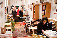 5 November, 2008. New York, NY. Owner Elspeth Treadwel talks to customers at the, Podunk, a self-styled &quot;American tearoom&quot; in the East Village. She left a career in publishing to open Podunk six years ago, in 2002.<br /> <br /> &copy;2008 Gianni Cipriano for The New York Times<br /> cell. +1 646 465 2168 (USA)<br /> cell. +1 328 567 7923 (Italy)<br /> gianni@giannicipriano.com<br /> www.giannicipriano.com