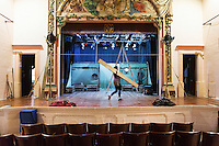 SLIEMA, MALTA - 8 FEBRUARY 2016: Stage manager Rebecca Austin sets up the stage of the touring Hamlet performed by the Shakespeare's Globe theatre company at the Salesian Theatre in Sliema, Malta, on February 8th 2016.<br /> <br /> The touring Hamlet, performed by the Shakespeare's Globe theatre company, is part of the Globe to Globe tour that set off in April 2014 (on the 450th anniversary of Shakespeare's birth) with the ambitious intention of visiting every country in the world over 2 years. The crew is composed of a total of sixteen men and women: four stage managers and twelve twelve actors  actors perform over two dozen parts on a stripped-down wooden stage. So far Hamlet has been performed in over 150 countries, to more than 100,000 people and travelled over 150,000 miles. The tour was granted UNESCO patronage for its engagement with local communities and its promotion of cultural education. Hamlet was also played for many dsiplaced people around the world. It was performed in the Zaatari camp on the border between Syria and Jordan, for Central African Republic refugees in Cameroon, and for Yemeni people in Djibouti. On February 3rd it was performed to about 300 refugees in Calais at the camp known as the Jungle.