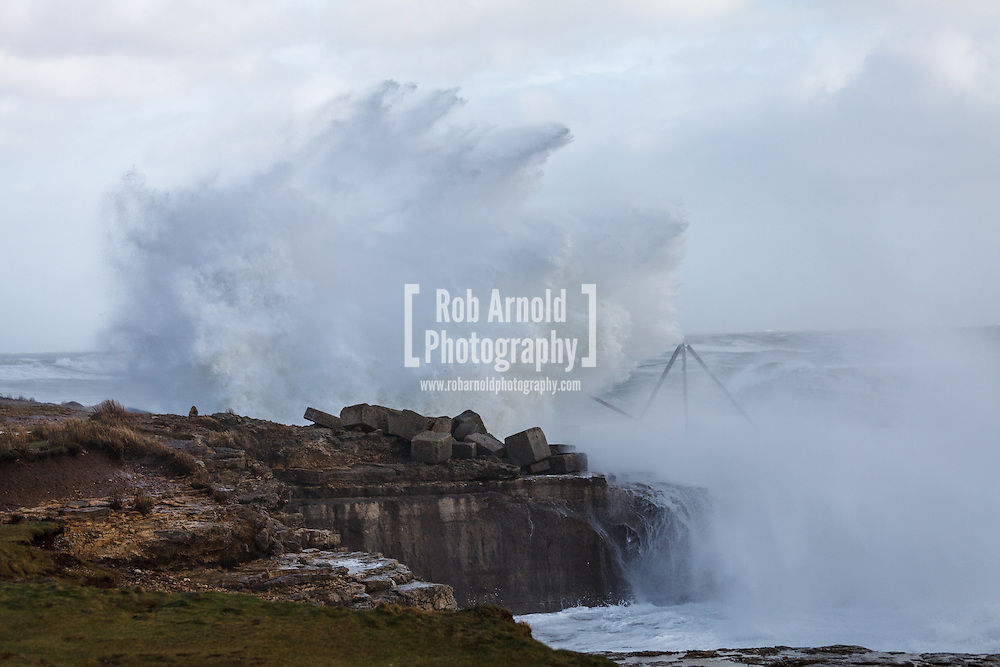 08/02/2014 - Portland Bill, Dorset, UK - Large waves crashing over rocks at Portland Bill, Dorset. The UK has been subjected to wave after wave of stormy weather in early 2014. Photo by Rob Arnold