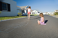 South Africa Cape Town two girls playing hopscotch on street
