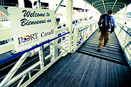 A student boarding the MV Explorer for a voyage that will circumnavigate the globe beginning in Vancouver, Canada.  The Institute for Shipboard Education's Semester at Sea program offers programs in international education for college students from around the globe.