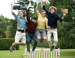 © Licensed to London News Pictures.22/08/2013. Solihull, West Midlands, UK. Solihull School achieved outstanding GSCE Level Results this year, up on previous years, with 77% of pupils gaining A grade or A Stars. Pictured, jumping for joy, from left, Sam Ashby, Ahmed Qureshi, Oscar Haynes, Ben Davidson. Photo credit : Dave Warren/LNP