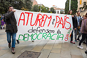 Aturem ee País Defensem La Democracia - We Stop The Country, We Defend Democracy. <br /> General Strike in Catalonia: Protestors in Placa Octavia, Sant Cugat as part of a strike that also saw major motorways being closed, in protest of the Spanish governments seizing of Catalan media, public services overall autonomy, and the jailing of Catalan government ministers and activists. Dave Walsh 2017. davewalshphoto.com