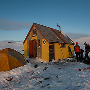 People outside the Icelandic Alpine Club hut in Tindfjöll mountain range, Iceland.