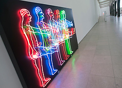 Light installation sculpture by Bruce Nauman titled Five Marching Men at Hamburger Bahnhof Museum of Contemporary Art in Berlin Germany