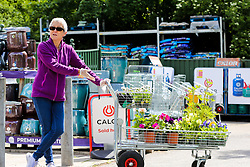 © Licensed to London News Pictures. 14/05/2020. London, UK. A woman with plants on a trolley in Capital Gardens in Alexandra Palace, north London after the government eased the COVID-19 lockdown, allowing garden centres to open after seven weeks. Photo credit: Dinendra Haria/LNP