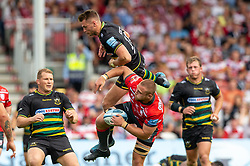 Northampton Saints' Dan Biggar and Gloucester Rugby's Ruan Ackermann during the Gallagher Premiership match at Kingsholm Stadium, Gloucester.