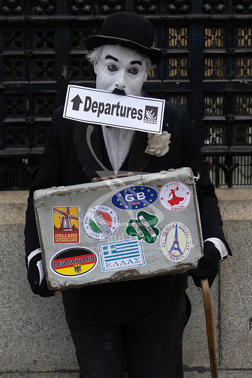 A man dressed as Charlie Chaplin stands outside the entrance to the Houses of Parliament in London as MPs inside debate Prime Minister Theresa May's Brexit deal with a lot to be held in the evening. London, January 15 2019.