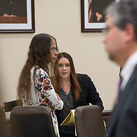 Defendant Deborah Green, in the flower dress, stands with her defense as the court goes into a quick recess before the first witness is brought into the courtroom on Day 1 of the Green Case at the 13th Judicial District Courthouse in Grants Tuesday afternoon.