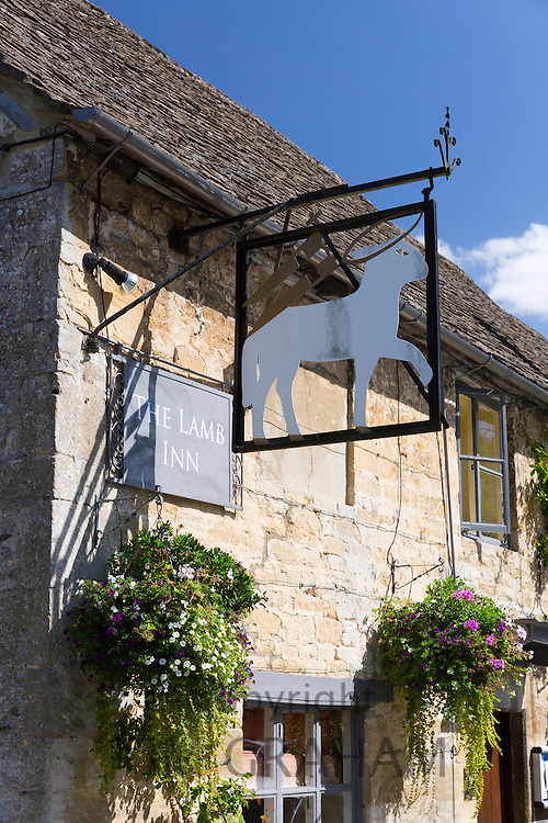 Pub sign of the Lamb Inn Hotel a traditional old gastro pub hotel in Burford, The Cotswolds, Oxfordshire, UK