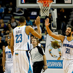 Jan 7, 2013; New Orleans, LA, USA; New Orleans Hornets point guard Greivis Vasquez (21) and power forward Anthony Davis (23) celebrate after a basket during the fourth quarter of a game against the San Antonio Spurs at the New Orleans Arena. The Hornets defeated the Spurs 95-88. Mandatory Credit: Derick E. Hingle-USA TODAY Sports
