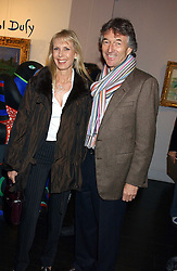 STUART & SUSAN CROSSLEY she was Susan Sangster at the opening of an exhibition of paintings and watercolours by Raoul Dufy held at the Opera Gallery, 134 New Bond Street, London W1 on 6th February 2006.<br />