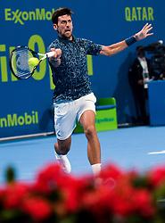 Novak Djokovic of Serbia returns the ball to  Damir Dzumhur of Bosnia during their first round of ATP Qatar Open Tennis match at the Khalifa International Tennis Complex in Doha, capital of Qatar, on January 01, 2019. Djokovic  won 2-0  (Credit Image: © Nikku/Xinhua via ZUMA Wire)