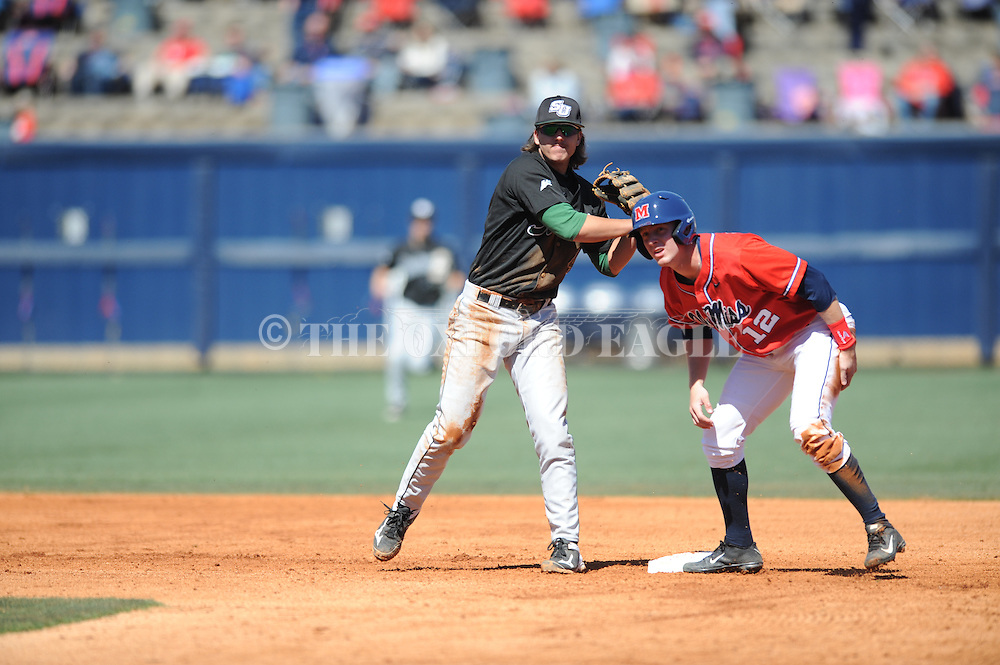 Ole Miss' J.B. Woodman is forced out by Stetson's Colton Lightner (4) on a double play at Oxford-University Stadium in Oxford, Miss. on Saturday, March 7, 2015. Ole Miss won 8-3 to improve to 7-5.