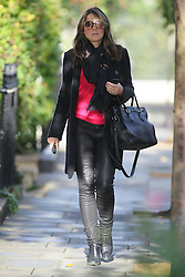 Liz Hurley wearing a black coat, scarf, red jumper and leather trousers leaving her London home. UK. 17/10/2012<br />BYLINE MUST READ : GOTCHAIMAGES.COM<br /><br />Copyright by © Gotcha Images Ltd. All rights reserved.<br />Usage of this image is conditional upon the acceptance <br />of Gotcha Images Ltd, terms and conditions available at<br />www.gotchaimages.com