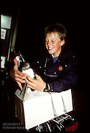 Hinrik Birgisson boxes a puffin chick he rescued that night for release to sea next day; Heimaey Iceland