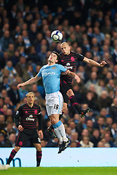 MANCHESTER, ENGLAND - Wednesday, March 24, 2010: Everton's John Heitinga and Manchester City's Gareth Barry during the Premiership match at the City of Manchester Stadium. (Photo by David Rawcliffe/Propaganda)
