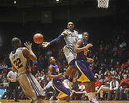 "Ole Miss guard Dundrecous Nelson (5)  passes to Ole Miss guard Zach Graham (32)  at the C.M. ""Tad"" Smith Coliseum in Oxford, Miss. on Wednesday, February 9, 2011. Ole Miss won 66-60 and is now 4-5 in the Southeastern Conference."