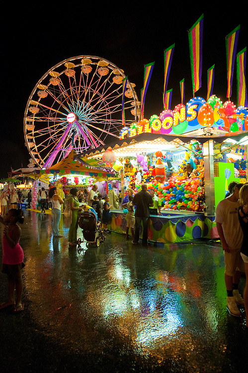 Ferris wheel and carnival stands