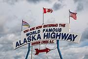 "Mile 0 of the Alaska Highway, at Dawson Creek, in British Columbia, Canada. The Alaska Highway was built as a military road during World War II in just 9 months in 1942, to link existing airfields via Canada to the territory of Alaska. The ALCAN Highway (a military acronym for Alaska-Canada) opened to the public in 1948. It begins in Dawson Creek, British Columbia, and runs via Whitehorse, Yukon to Delta Junction, Alaska. The ""Alaskan Highway"" is comprised of British Columbia Highway 97, Yukon Highway 1 and Alaska Route 2. While the ALCAN measured 2700 kilometers (1700 mi) upon completion in 1942, by 2012 it was rerouted and shortened to 2232 km (1387 mi). Once legendary for being a rough, challenging drive, the highway is now paved over its entire length. Delta Junction, at the end of the highway, claims ""Historic Milepost 1422"" where the Alaska Highway meets the Richardson Highway, which continues 96 mi (155 km) to the city of Fairbanks at Historic Milepost 1520, often (but unofficially) regarded as the northern portion of the Alaska Highway (although its Mileposts are measured from Valdez)."
