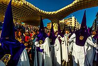 Hooded Penitents (Nazarenos) in the procession of the Brotherhood (Hermandad) San Benito, Holy Week (Semana Santa), Seville, Andalusia, Spain.