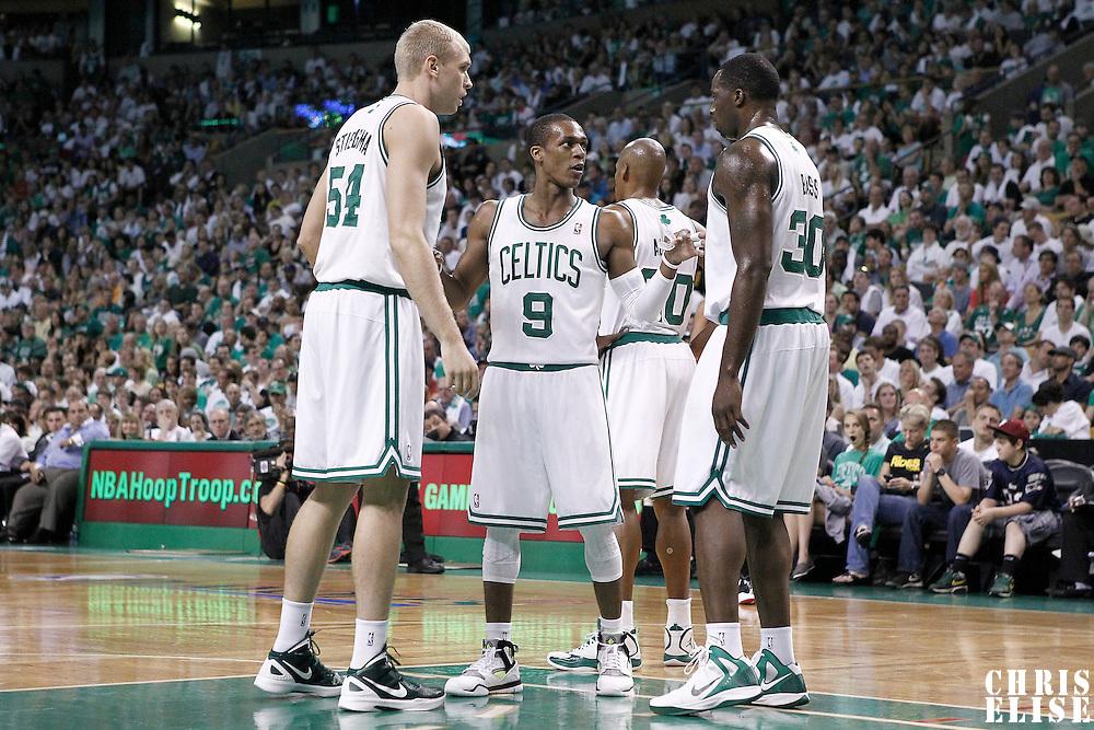 26 May 2012: Boston Celtics point guard Rajon Rondo (9) talks to Boston Celtics power forward Brandon Bass (30) and Boston Celtics center Greg Stiemsma (54) during the Boston Celtics 85-75 victory over the Philadelphia Sixer, in Game 7 of the Eastern Conference semifinals playoff series, at the TD Banknorth Garden, Boston, Massachusetts, USA.