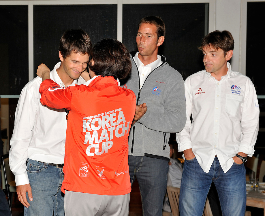Ann Hae Young presents Mathieu Richard with a present at the opening dinner. Photo:Chris Davies/WMRT