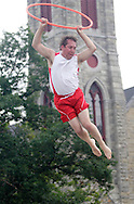 Goshen, NY - Ken Kovach of the Skyriders, an acrobatic trampoline team, jumps high into the air at the Great American Weekend festival on July 5, 2008. Kovach is a three-time national trampoline champion.