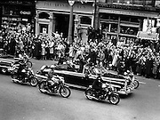 President Kennedy parades though Dublin.  The crowd on O'Connell Street cheers as the President passes..26.06.1963.President  John F. Kennedy driving through the streets in Dublin, Ireland. 19 October 1963; US President John F Kennedy travelling through Dublin's O'Connell Street in an open-topped car, during his visit to Ireland