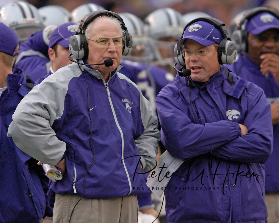Kansas State head coach Bill Snyder (L) stands on the sidelines with defensive coordinator Bob Elliott (R), during the second quarter at Bill Snyder Family Stadium in Manhattan, Kansas, November 19, 2005.  K-State defeated the Missouri Tigers 36-28.