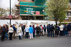 Maida Vale, London, April 26th 2015. Dozens of local residents and regulars gather outside the much loved, partially demolished Carlton Tavern in Maida Vale to protest against its sudden, illegal demolition by property developers. They demand that the pub, rebuilt in 1920 following a World War One zeppelin bombing is once again rebuilt brick-by-brick, saying that any fines levied by the council will have een factored into the development budget.
