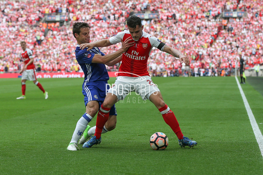 Chelsea's César Azpilicueta(28) and Arsenal's GranitXhaka(29) battle for possession  during the The FA Cup final match between Arsenal and Chelsea at Wembley Stadium, London, England on 27 May 2017. Photo by Shane Healey.