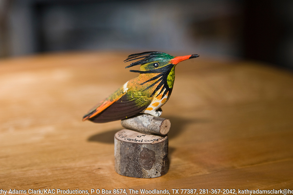 Small statues of birds, like this carving of a black-crested coquette hummingbird, are popular with tourists visiting Costa Rica.  Visitors like these little statues because they are inexpensive and easy to pack.  Birdwatchers and nature enthusiast make up a large segement of the thousands of tourists who visit the country each year.  A statue like this is available at the gift shop in the Savegre Mountain Lodge for $10 U.S.