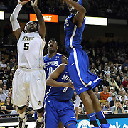 Central Florida guard Marcus Jordan (5) drives to the basket against Memphis forward Tarik Black (10), and Memphis guard Chris Crawford (3) during a Conference USA NCAA basketball game between the Memphis Tigers and the Central Florida Knights at the UCF Arena on February 9, 2011 in Orlando, Florida. Memphis won the game 63-62. (AP Photo: Alex Menendez)