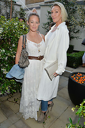 Left to right, ELLIE SHEPHERD and OLIVIA BUCKINGHAM at a party to celebrate the launch of Le Jardin de Monsieur Li by Hermes in association with Mr Fogg's was held at Hermes, 155 New Bond Street, London on 9th July 2015.