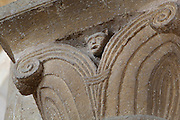 Carved capital with scrolls and animal head, in the North transept of the Abbatiale Sainte-Foy de Conques or Abbey-church of Saint-Foy, Conques, Aveyron, Midi-Pyrenees, France, a Romanesque abbey church begun 1050 under abbot Odolric to house the remains of St Foy, a 4th century female martyr. The church is on the pilgrimage route to Santiago da Compostela, and is listed as a historic monument and a UNESCO World Heritage Site. Picture by Manuel Cohen