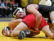 Iowa's Tony Ramos works on Southern Illinois Edwardsville's John Petrov during the 133-pound bout of their dual at Carver-Hawkeye Arena, 1 Elliot Drive in Iowa City on Friday evening January 7, 2010. Ramos defeated Petrov 20-5 in a technical fall and Iowa defeated Southern Illinois Edwardsville 49-0.