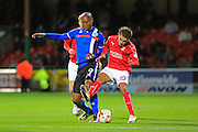 Johnny Goddard challenges Calvin Andrew during the EFL Sky Bet League 1 match between Swindon Town and Rochdale at the County Ground, Swindon, England on 18 October 2016. Photo by Daniel Youngs.