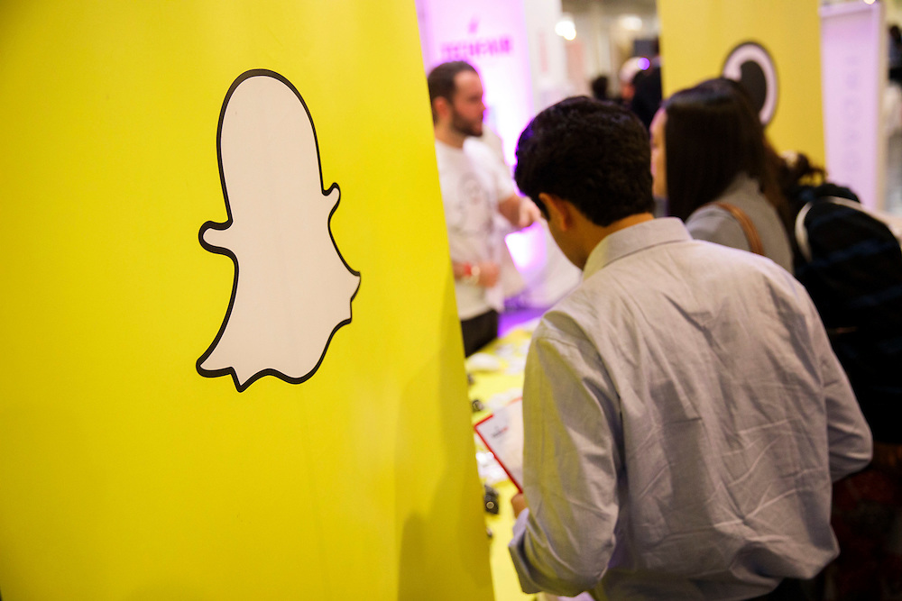 The Snapchat ghost logo is displayed during the TechFair LA job fair in Los Angeles, California, U.S., on Thursday, January 26, 2017. Snap Inc., parent company of the Snapchat app has filed documents for an initial public offering (IPO) with the Securities and Exchange Commission (SEC). © 2017 Patrick T. Fallon