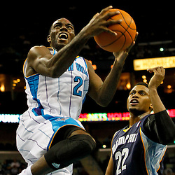 December 21, 2011; New Orleans, LA, USA; New Orleans Hornets small forward Quincy Pondexter (20) shoots past Memphis Grizzlies small forward Rudy Gay (22) during the first quarter of a preseason game at the New Orleans Arena.  The Hornets defeated the Grizzlies 95-80.  Mandatory Credit: Derick E. Hingle-US PRESSWIRE