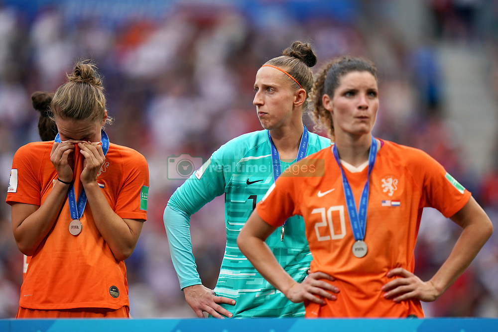 Netherlands goalkeeper Sari van Veenendaal (centre) and team-mate Dominique Bloodworth (right) appear dejected after receiving their runner-up medals after the final whistle