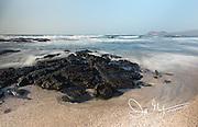Beach and rocky coastline of Santiago island, Galapagos islands, Ecuador.