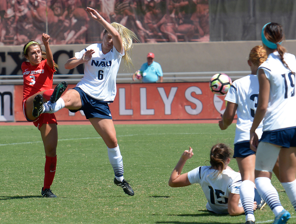 gbs091717l/SPORTS -- Jennifer Munoz, 3, scores on kick past Northern Arizona's Madeline Waszak, 6, during the game at the UNM Soccer Complex on Sunday, September 17, 2017. (Greg Sorber/Albuquerque Journal)