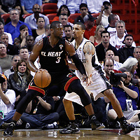 14 March 2011: San Antonio Spurs point guard George Hill (3) defends on Miami Heat shooting guard Dwyane Wade (3) during the Miami Heat 110-80 victory over the San Antonio Spurs at the AmericanAirlines Arena, Miami, Florida, USA.