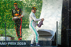 March 17, 2019 - Albert Park, VIC, U.S. - ALBERT PARK, VIC - MARCH 17: Champagne flies with Valtteri Bottas and Max Verstappen on the podium at The Australian Formula One Grand Prix on March 17, 2019, at The Melbourne Grand Prix Circuit in Albert Park, Australia. (Photo by Speed Media/Icon Sportswire) (Credit Image: © Steven Markham/Icon SMI via ZUMA Press)
