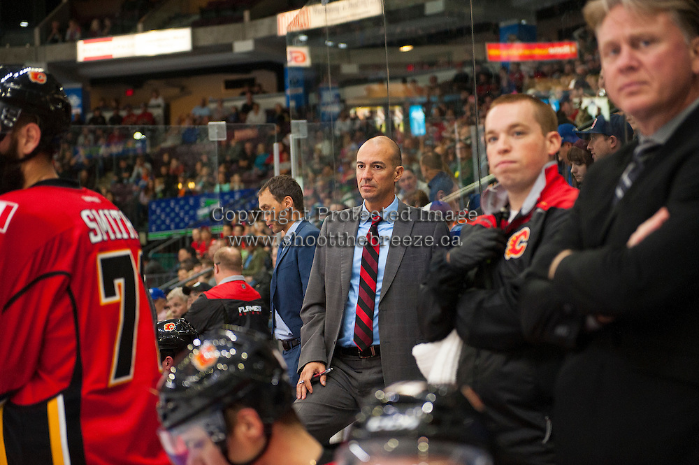 PENTICTON, CANADA - SEPTEMBER 17: Calgary Flames head coach, Ryan Huska, stands on the bench against the Edmonton Oilers on September 17, 2016 at the South Okanagan Event Centre in Penticton, British Columbia, Canada.  (Photo by Marissa Baecker/Shoot the Breeze)  *** Local Caption *** Ryan Huska;