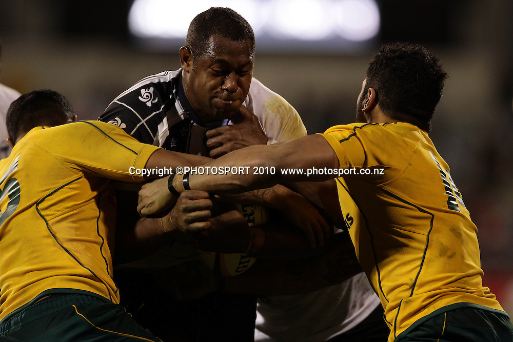 Jone Qovu<br />  tackled by Huai Edmonds<br /> International Test rugby union match, Australia v Fiji, Canberra, Australia. Saturday 5 June 2010. Photo: Paul Seiser/PHOTOSPORT