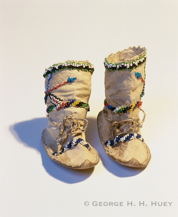 0193-1019B ~ Copyright: George H. H. Huey ~ Historic Chiricahua Apache Indian children's moccasins. Circa 1910, Arizona. 4 3/4 inches long. Arizona State Museum collection no.87-22-152.