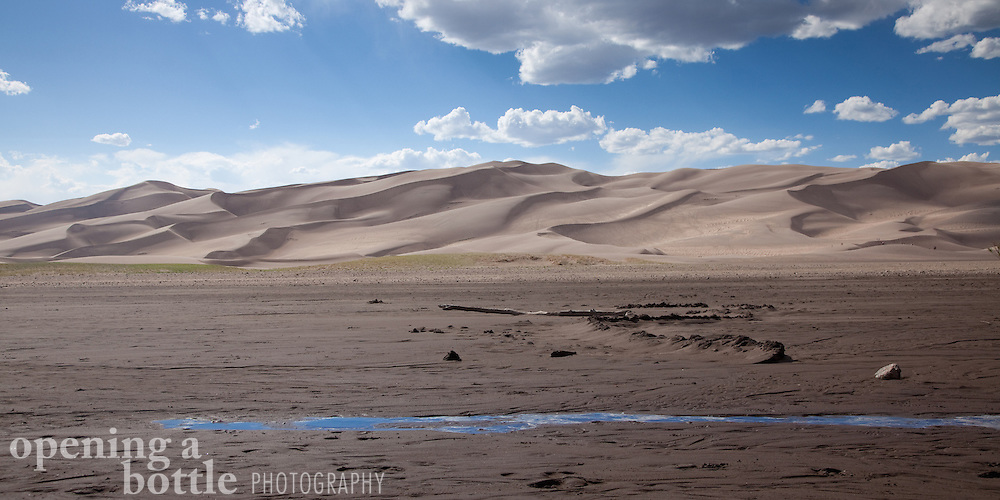 Medano Creek comes to an untimely end at the base of the dune field, Great Sand Dunes National Park, Colorado. Full size image available upon request.