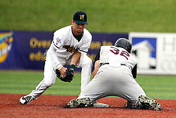09 June 2011: Tyler Keeble tags out Scott Houin at 2nd base during a game between the Lake Erie Crushers and the Normal Cornbelters at the Corn Crib in Normal Illinois.
